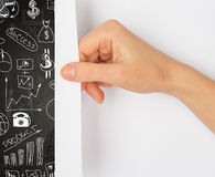 Hand turning page Stock Photography
