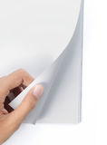 Hand turning page of blank magazine. Hand turning page of blank cover magazine royalty free stock photo