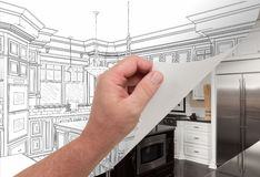 Hand Turning Page of Custom Kitchen Drawing to Photograph. Male Hand Turning Page of Custom Kitchen Drawing to Finished Photograph Underneath Stock Image