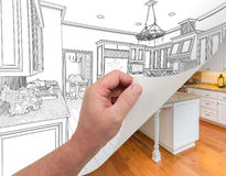 Hand Turning Page of Custom Kitchen Drawing to Photograph. Male Hand Turning Page of Custom Kitchen Drawing to Finished Photograph Undreneath Stock Photography