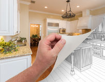 Hand Turning Page of Custom Kitchen Photograph to Drawing. Male Hand Turning Page of Custom Kitchen Photograph to Drawing Undreneath Royalty Free Stock Images