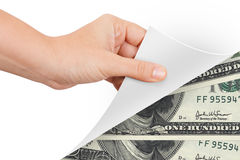 Hand Turning Page to Banknotes Royalty Free Stock Image