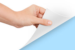 Hand Turning Page to Blue Stock Images