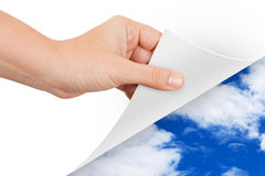 Hand Turning Page to Weather royalty free stock photos
