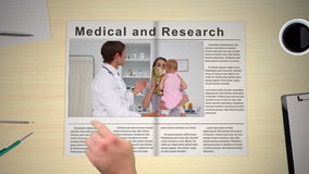 Hand turning pages of medical newspaper stock video