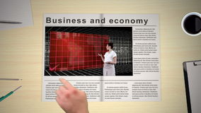 Hand turning pages of world news business magazine