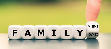 Free Hand Turns A Dice And Changes The Expression `family Second` To `family First`. Stock Images - 169973564