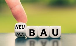 Free Hand Turns A Dice And Changes The German Word `Altbau` `old Construction` In English To `Neubau` `new Construction` In Stock Photos - 166421973