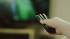 Hand with tv remote stock footage