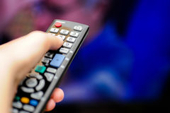 Hand with tv remote control Stock Photo