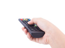 Hand with tv remote control isolated on white Stock Images