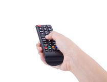 Hand with tv remote control isolated on white Stock Photos