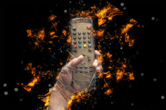 Hand with tv remote control tied with wire Royalty Free Stock Photos