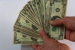 Hand twee die een ventilator van dollars houden royalty-vrije stock foto