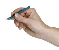 Hand and tweezers Royalty Free Stock Photography
