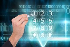 Hand with tweezers pointing at numpad Royalty Free Stock Photo