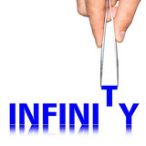 Hand with tweezers and word infinity. Concept, isolated on  background Royalty Free Stock Photo