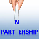 Hand with tweezers and word Partnership Stock Photography