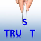 Hand with tweezers and word Trust Stock Images
