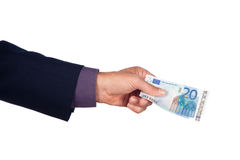 Hand with twenty euro banknote. Male hand with twenty euro  banknote on a white background Stock Images