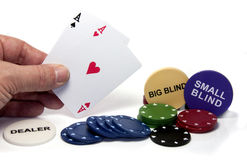 Hand with two aces during poker game Stock Photos