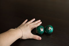Hand and two ball on the table Stock Photo