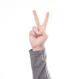 Hand with two fingers concept of victory sign isolated on white background. Male hand with two fingers concept of victory sign isolated on white background Royalty Free Stock Images