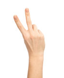 Hand with two fingers up in the peace or victory symbol. The sign for V letter in sign language isolated on white background Stock Photo