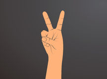 Hand with two fingers up in the peace or victory symbol. Also the sign for the letter V in sign language.Man or woman hand. Royalty Free Stock Photos
