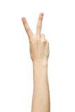 Hand with two fingers up in the peace or victory symbol Stock Photo