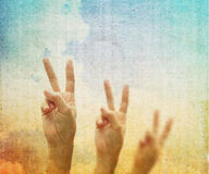 Hand with two fingers up in the peace or victory symbol. Royalty Free Stock Image