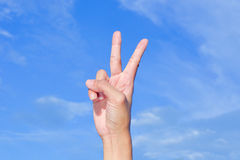 Hand with two fingers up victory Stock Images