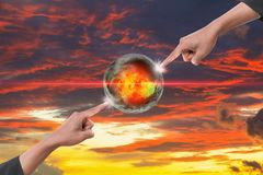 Hand two point on world hot on sky red idea global warming on sky red sunset background.  Stock Photography