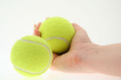 Hand with two tennis balls Royalty Free Stock Images