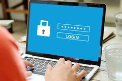 Hand tying laptop computer with password login on screen, cyber. Security concept stock photos