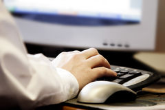 Hand Type Computer. Close-up of a man's hand typing at a computer keyboard stock image