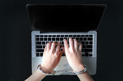 Hand type computer laptop for crime. Hand with bracelet type computer criminal concept royalty free stock images