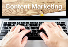 Hand type on laptop with content Marketing word with blur backgr. Ound, Digital Marketing concept Royalty Free Stock Image