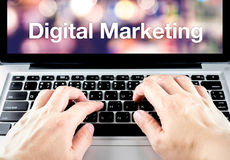 Hand type on laptop with Digital Marketing word with blur backgr. Ound, Digital Marketing concept Stock Images