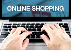 Hand type on laptop with online shopping word with blur backgrou. Nd, Digital Marketing concept Royalty Free Stock Image
