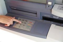 Hand type the secret code in the keyboard of the ATM. Girl hand type the secret code in the keyboard of the ATM to take money Stock Image