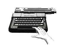 Hand on a typewriter Stock Images