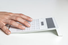 Hand typing on calculator Royalty Free Stock Photography
