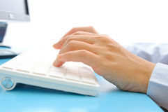 Hand typing on computer keyboard Royalty Free Stock Image