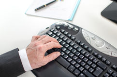 Hand typing on a computer keyboard Royalty Free Stock Photography