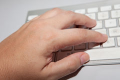 Hand typing in computer keyboard Stock Photography