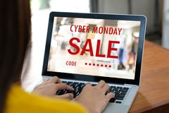 Hand typing discount coupon code on laptop screen to get the sho. Pping on line cyber monday promotion, on line shopping ,digital marketing business and Royalty Free Stock Image