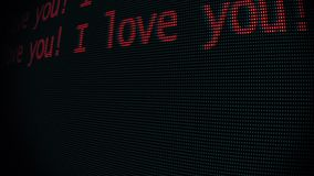 Hand typing i love you words writing on old led lcd tube computer display screen close up pixel animation - new quality. Retro vintage futuristic wording stock video
