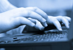 Hand typing on keyboard. Close up of a hand typing on keyboard royalty free stock image