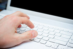 Hand typing on keyboard. Male hand typing on keyboard Royalty Free Stock Images
